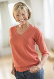 Confident Woman With Hands In Pockets Standing At Home royalty free stock photography
