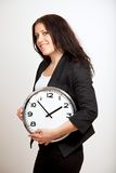 A Confident Woman Holding a Clock Royalty Free Stock Images