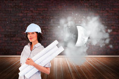 Confident woman holding construction plans. Composite image of confident woman holding construction plans Royalty Free Stock Images