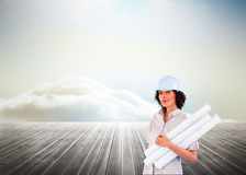 Confident woman holding construction plans Stock Photos