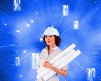 Confident woman holding construction plans. Composite image of confident woman holding construction plans Stock Photo
