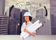 Confident woman holding construction plans Royalty Free Stock Image