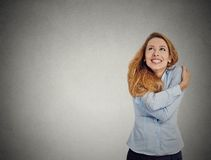 Confident woman holding hugging herself looking up Stock Images