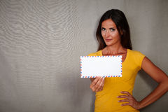 Confident woman holding mail while standing Royalty Free Stock Images