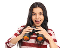 Confident woman holding a pair of binoculars Royalty Free Stock Photos