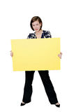Confident woman holding sign. An attractive young female holding a large blank message sign Royalty Free Stock Photo