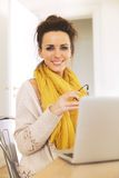 Confident Woman at Home Sitting Stock Image