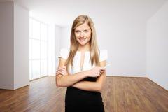 Confident woman in interior Stock Image