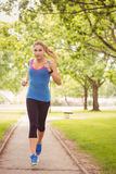Confident woman jogging in park Royalty Free Stock Photography