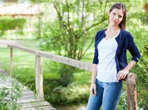 Confident Woman Leaning On Wooden Bridge Stock Images