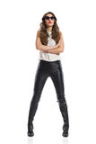 Confident Woman In Leather Pants Stock Image