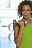 Confident Woman Lifting Dumbbell In Club Royalty Free Stock Photos
