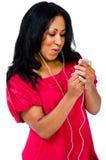 Confident woman listening music Royalty Free Stock Photo