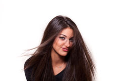 Confident woman with long hair smiling. Portrait of a young  confident woman with long hair posing Royalty Free Stock Photos