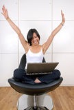 Confident woman looking happy. Working on laptop computer Royalty Free Stock Photos