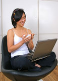 Confident woman looking happy. Working on laptop computer Royalty Free Stock Images