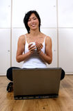 Confident woman looking happy. Working on laptop computer Royalty Free Stock Photography