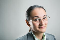 Confident woman looking through her spectacles Royalty Free Stock Image