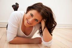 Confident Woman Lying on the Floor Stock Photos