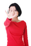 Confident woman making stop gesture Royalty Free Stock Photo