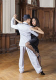 Confident Woman Performing With Male Tango Dancer. Portrait of confident women performing with male tango dancer in restaurant Royalty Free Stock Image