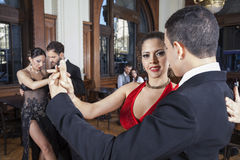 Confident Woman Performing Tango With Partner Stock Photo