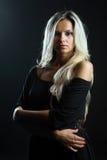 Confident woman portrait over dark background Stock Photo