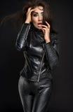 Confident woman portrait in black costume Stock Photos