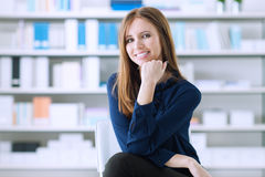 Confident woman posing in the office Stock Photos