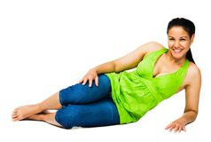 Confident woman reclining. And smiling isolated over white Stock Photo