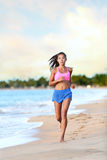 Confident Woman Runner Jogging On Beach Shore Royalty Free Stock Photo
