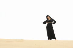 Confident woman on sand hill crest Royalty Free Stock Photography