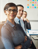 Confident woman seated with men in meeting stock photos