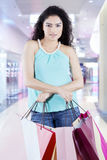 Confident woman with shopping bags at the mall Stock Photos