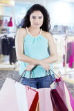 Confident woman with shopping bags in the store Stock Image