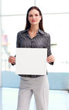 Confident woman showing a big business card Stock Images