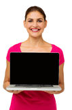 Confident Woman Showing Laptop Stock Photography