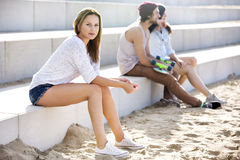 Confident Woman Sitting On Steps At Beach Royalty Free Stock Photography