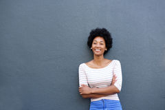 Confident woman smiling with arms crossed. Portrait of happy confident woman standing with arms crossed Stock Photos