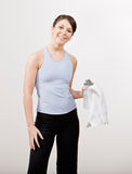 Confident woman in sportswear holding towel Royalty Free Stock Photography