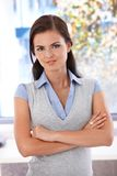Confident woman standing arms crossed Stock Image