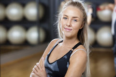 Confident Woman Standing Arms Crossed In Gym Royalty Free Stock Photo