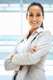 Confident woman standing with arms folded Royalty Free Stock Image