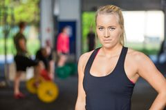 Confident Woman Standing in Gym Royalty Free Stock Photo