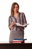 Confident woman teacher holding textbook standing Stock Images