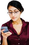 Confident woman text messaging Stock Photography