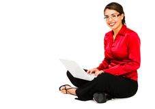 Confident woman using a laptop Stock Photography
