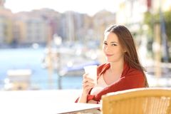 Confident woman on vacation posing in a bar stock photo