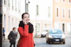 Confident woman walking in the city Stock Image