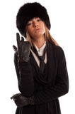 Confident woman wearing a black fur hat, black tie and leather g Stock Photography